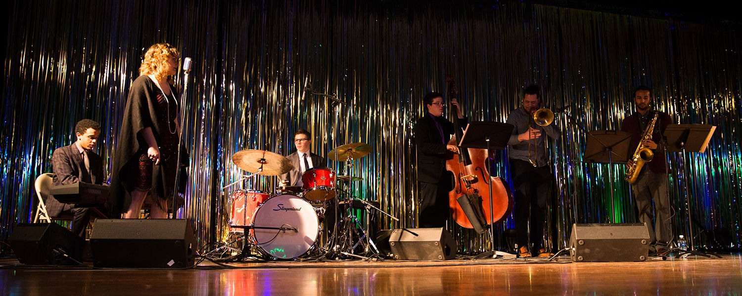The Kent State University Jazz Society Quartet performs while the models walk the runway.