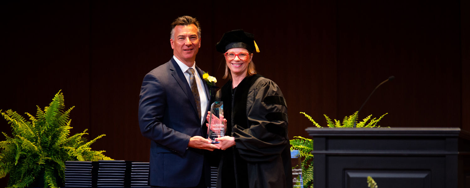 Mayor Yates accepting award from Dean at Commencement