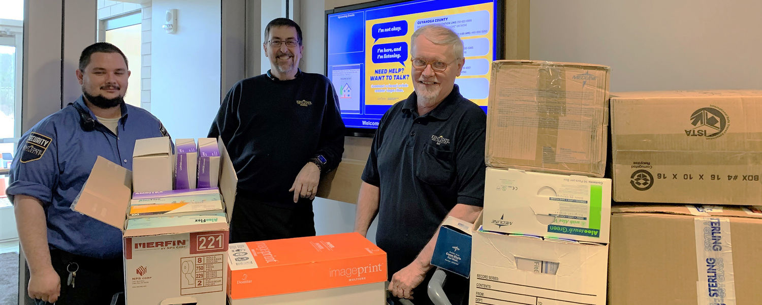 Kent State Geauga maintenance workers collecting boxes