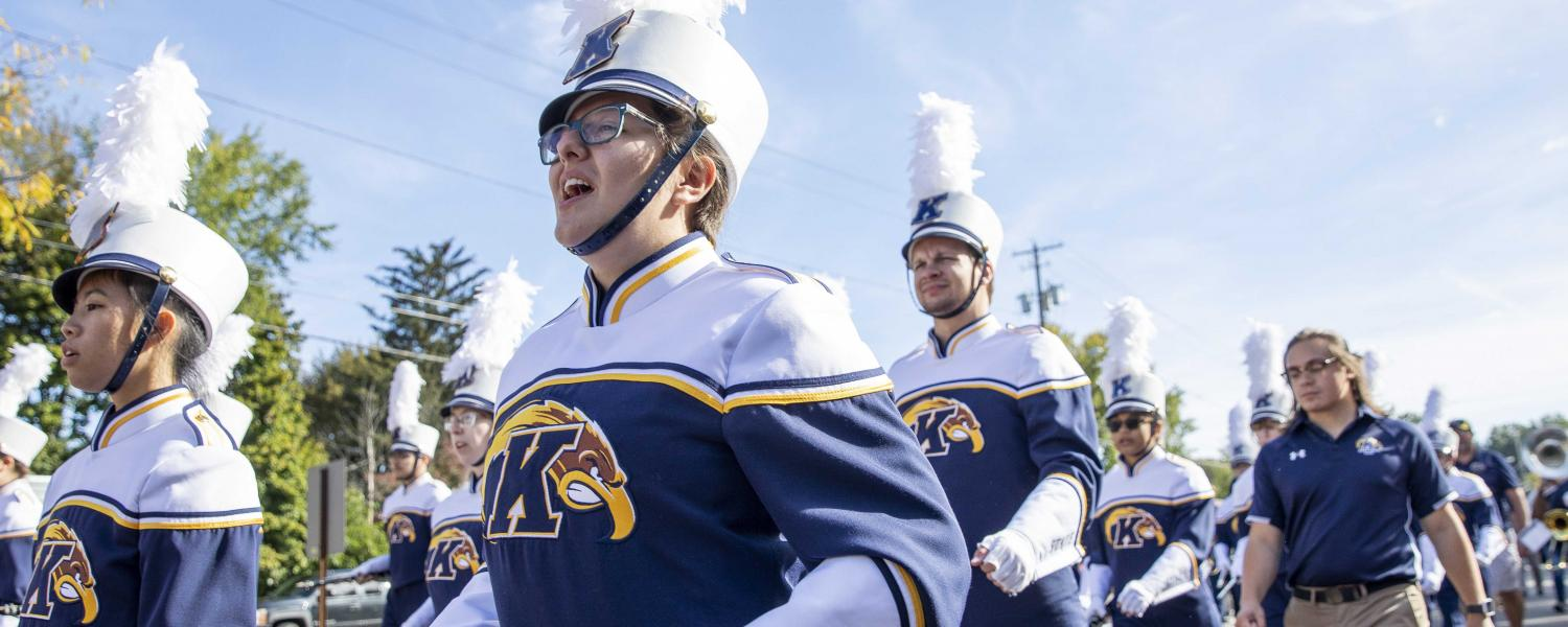The Marching Golden Flashes walk down Main Street during Kent State's Homecoming Parade.