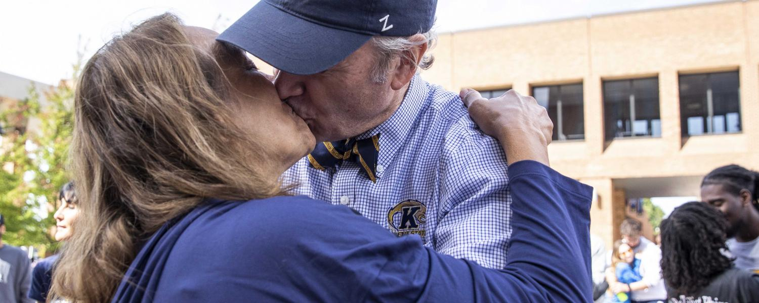 Kent State President Todd Diacon and his wife, Moema Furtado, along with other Kent State couples, participate in Kiss on the K during Homecoming 2021.