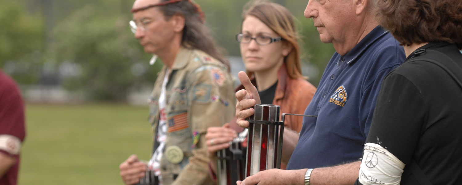 Members of the May 4 Task Force and others who stood vigil in the parking lot by Taylor Hall walk the candles from the lot to the Kent State Commons for the start of the May 4 commemoration.