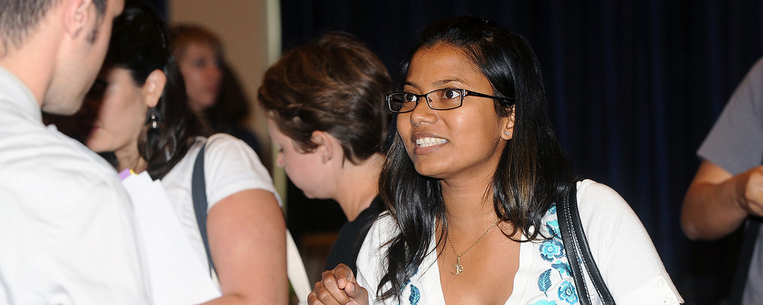 Students mingle during the Graduate Resource Fair, in the Student Center Ballroom.