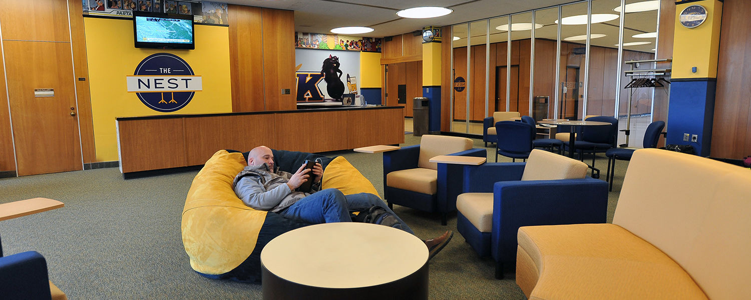 A student relaxes in the renovated Nest, on the second floor of the Student Center.