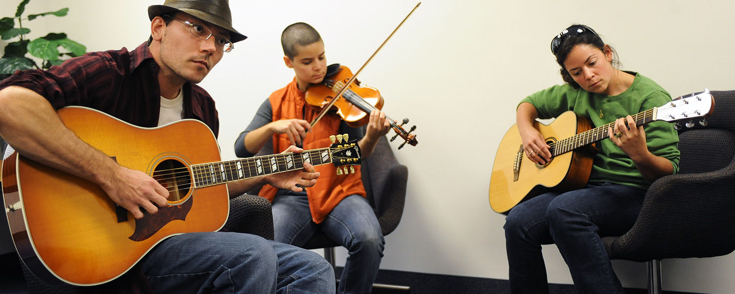 Musicians participate in the Kent State Folk Festival's music workshops and jam sessions at the Kent Student Center.