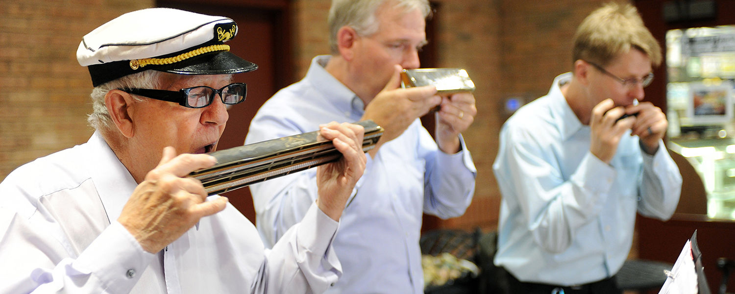 The Reed City Halwalker's Harmonica Quartet performs in Acorn Alley during the 2012 Kent State Folk Festival.