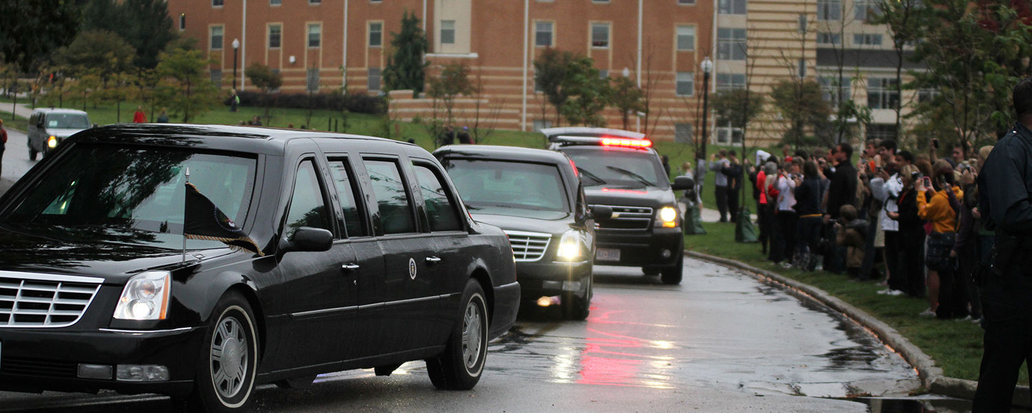 President Obama's motorcade makes its way down Midway drive en route to the MAC Center.