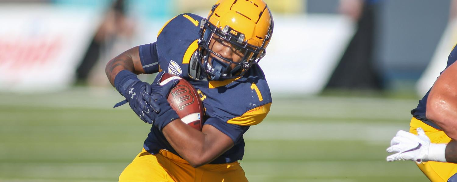 Kent State running back Marquez Cooper rushes the ball during the Homecoming football game against Bowling Green State University. The Golden Flashes beat the Falcons 27-20.