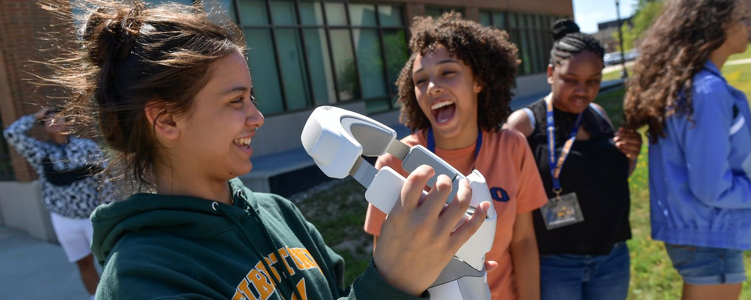 Firestone Community Learning Center students react to a drone flown by lecturer Jason Lorenzon at the Kent State University College of Aeronautics and Engineering.