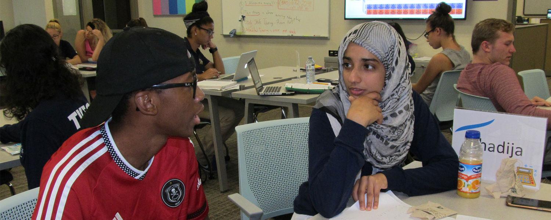 A student gets help at the Academic Success Center from tutor Khadija Al-Habsy