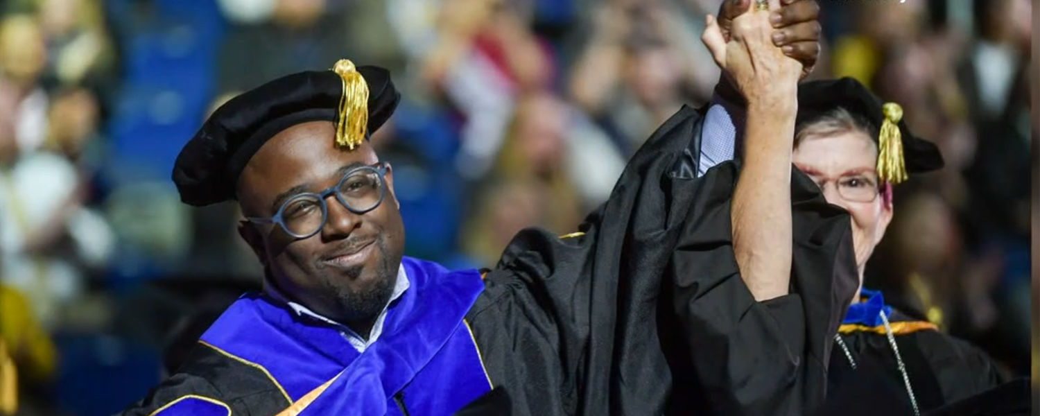 N.J. Akbar and his advisor at commencement