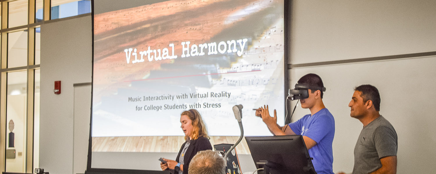 Students presenting on Virtual Harmony