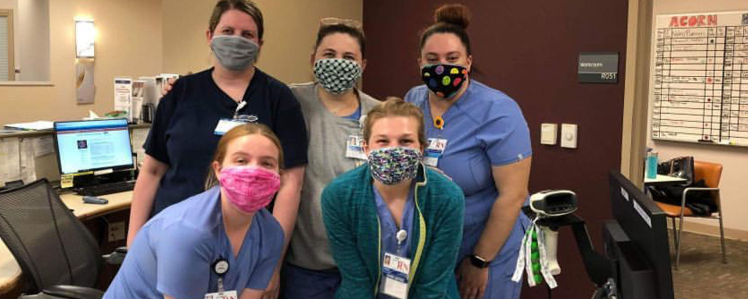 Nurses using masks created and donated by student Kent State Fashion student Allie Darish.