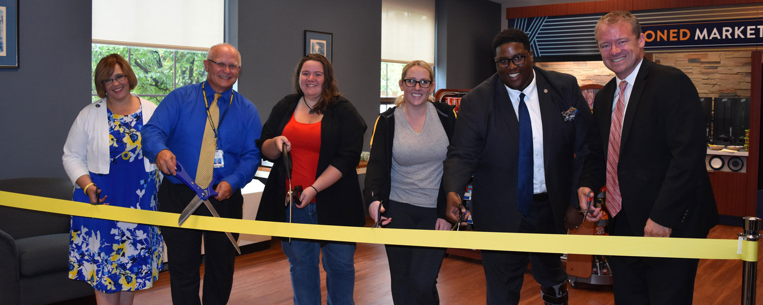 Cutting the ribbon for the Seasoned Market on the East Liverpool Campus