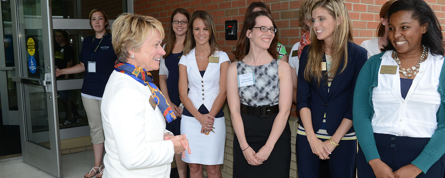 Kent State President Beverly Warren is greeted by members of the faculty and staff upon arriving at Kent State University at Ashtabula.