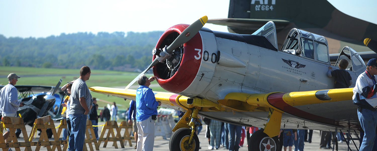 Visitors to Andrew W. Paton Field at the Kent State University Airport enjoy the sights and sounds of vintage aircraft on a sunny fall day.