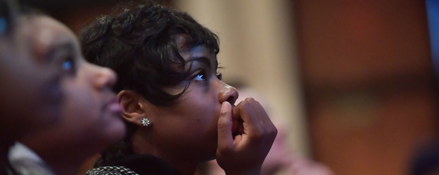 A Kent State student listens to a speaker during the university's 2017 Martin Luther King Jr. Celebration.