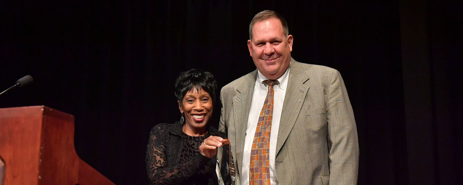 Vice President Ed Mahon accepts the Unity Award for Diversity on behalf of Kent State's Division of Information Services from Vice President for Diversity, Equity and Inclusion Alfreda Brown.