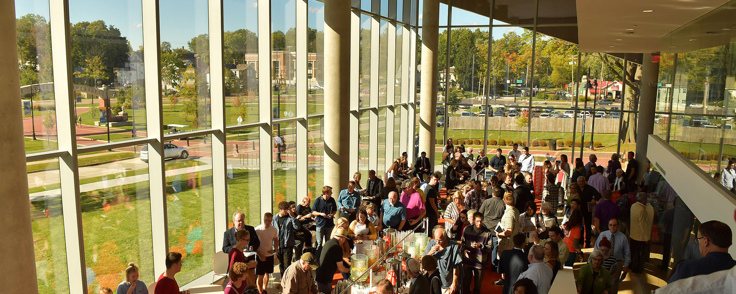 People attending the grand opening of Kent State's Center for Architecture and Environmental Design tour the new building and enjoy the downtown Kent vista.