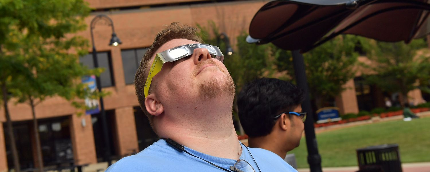 Kent State spectators look to the sky during the solar eclipse.