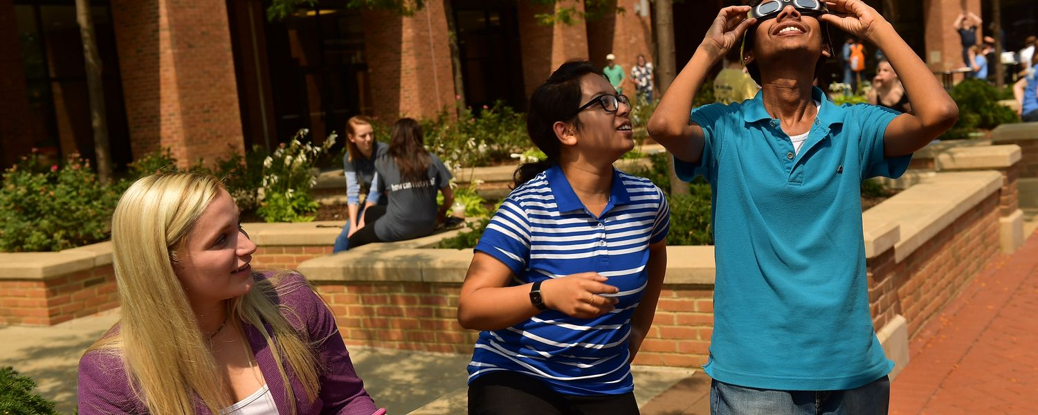 Kent State students wear safety glasses to view the solar eclipse.