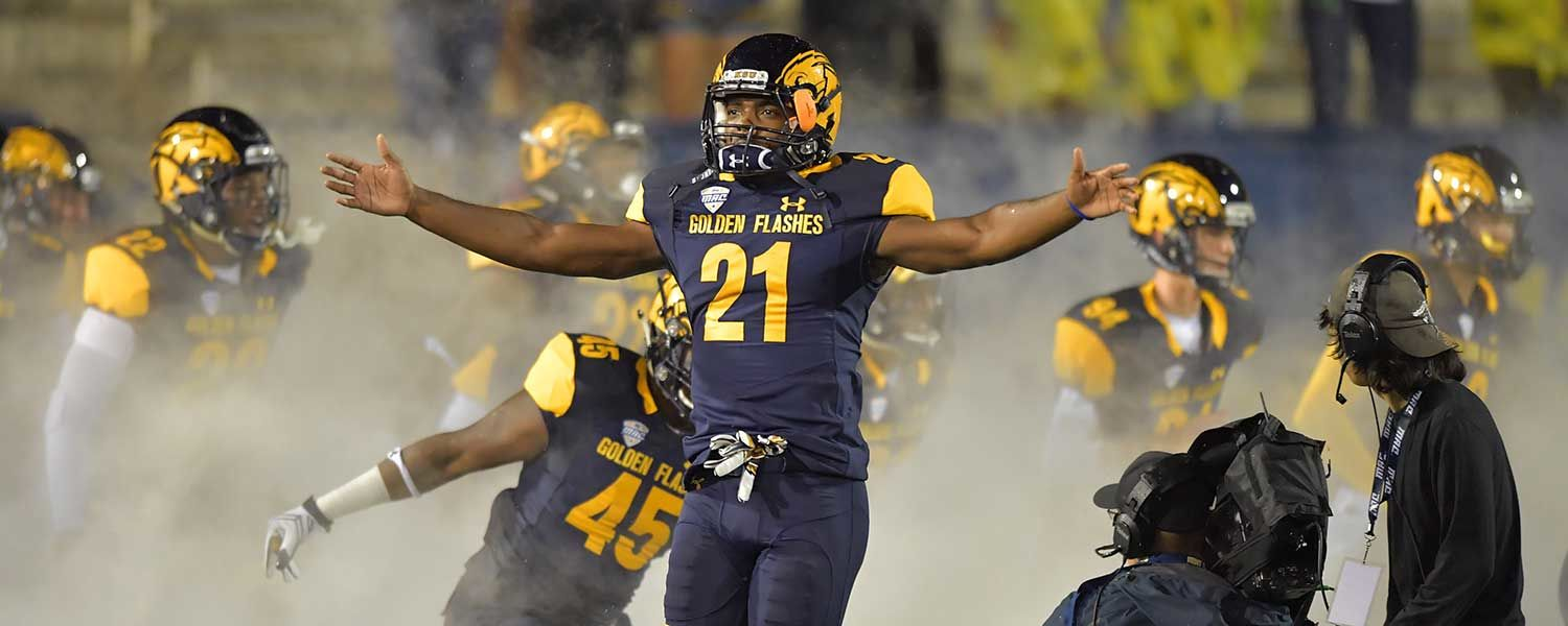 Kent State cornerback Demetrius Monday jumps in excitement before the football season opener against the Clemson Tigers.