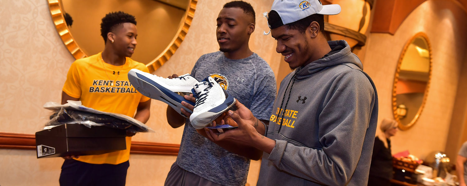 Kevin Zabo, Jimmy Hall and Leo Edwards react to receiving shoes, shirts and other items from Under Armor.