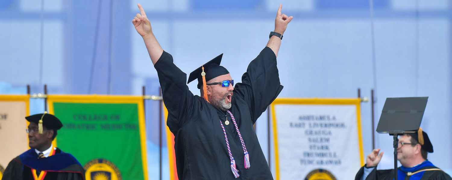 A Kent State graduate from a Regional Campus and veteran crosses the stage.