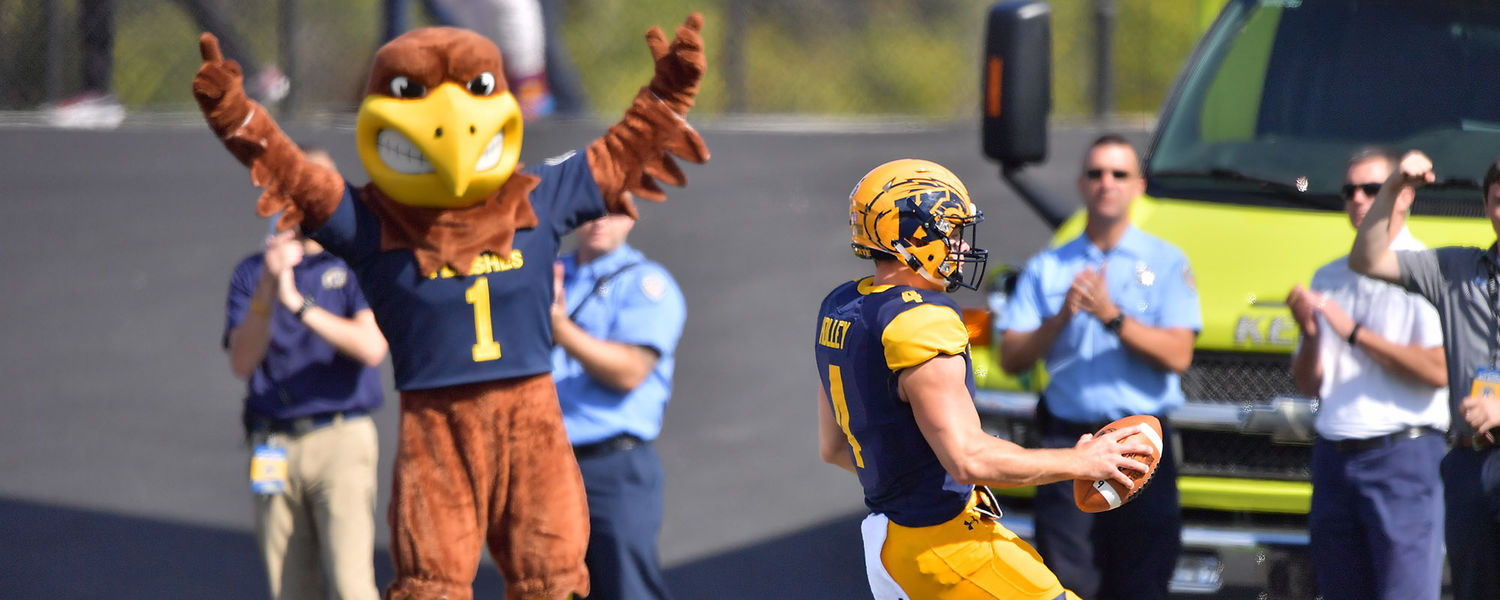 Kent State quarterback Nick Holley scores the first touchdown of the season as Flash, the university's mascot, signals a touchdown.