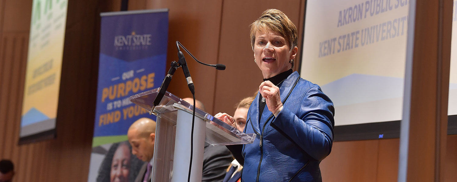 Kent State President Beverly J. Warren gives remarks during the event announcing the university's partnership with Akron Public Schools for three new college and career academies at Firestone Community Learning Center.