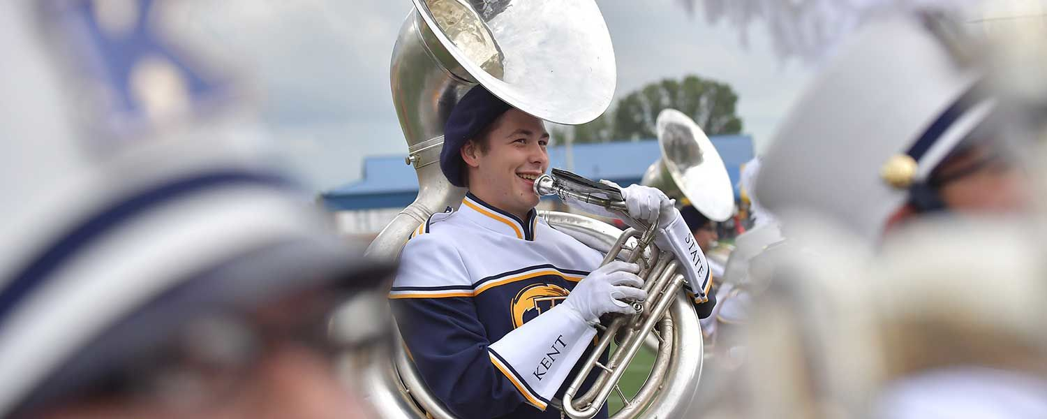 A member of the Kent State Marching Golden Flashes smiles during a performance at Dix Stadium during the 2016 season.