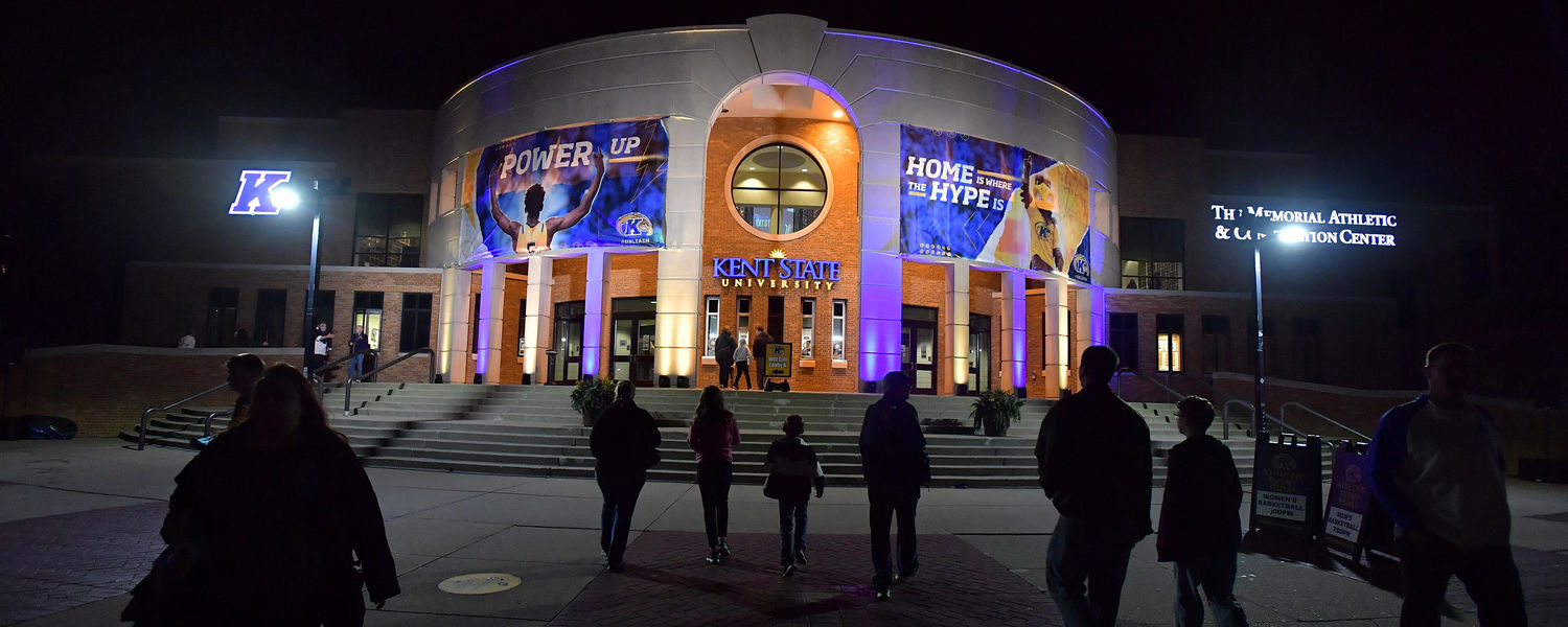The outside of the MAC Center is illuminated in blue and gold prior to the Kent State men's basketball game.