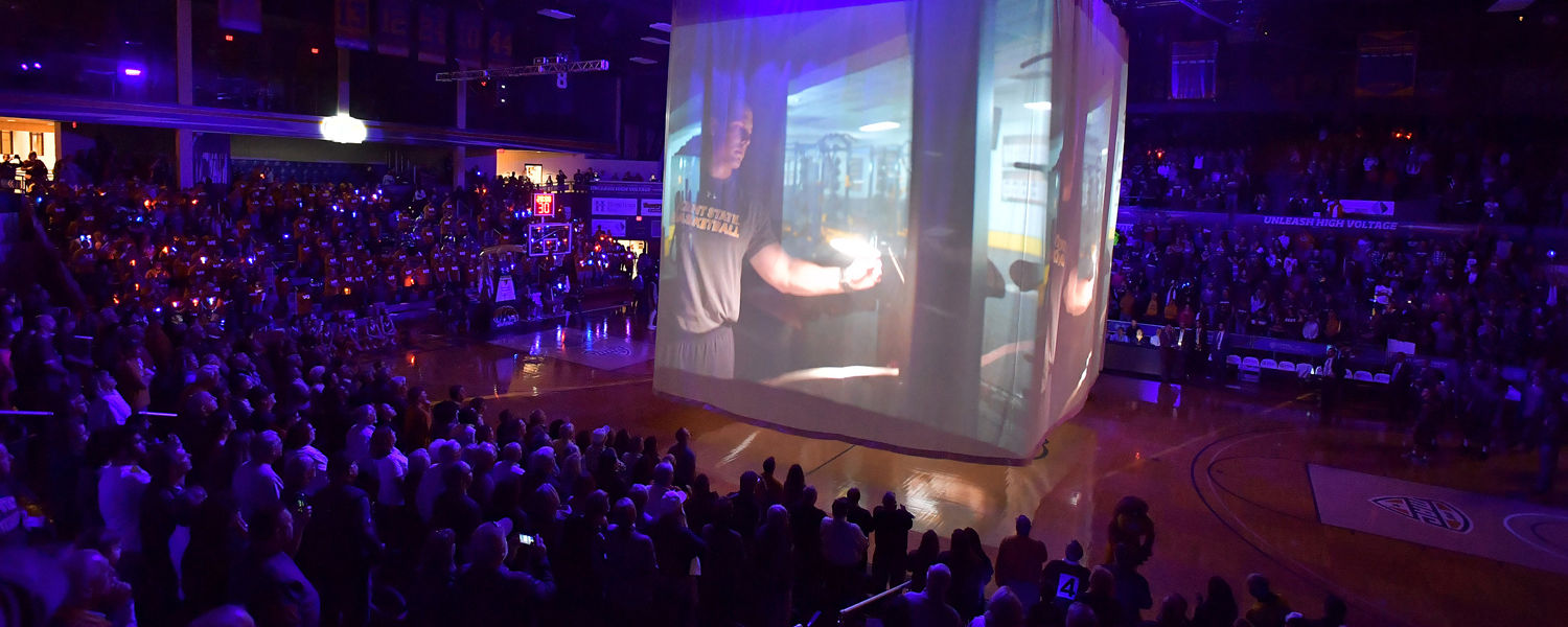 The new Kent State Athletics video plays on screens surrounding the scoreboard before the start of the men's basketball game.