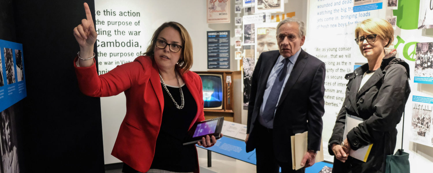 Legendary journalist Bob Woodward (center) and his wife, Elsa (right), get a tour of Kent State's May 4 Visitors Center from the center's director, Mindy Farmer (left).