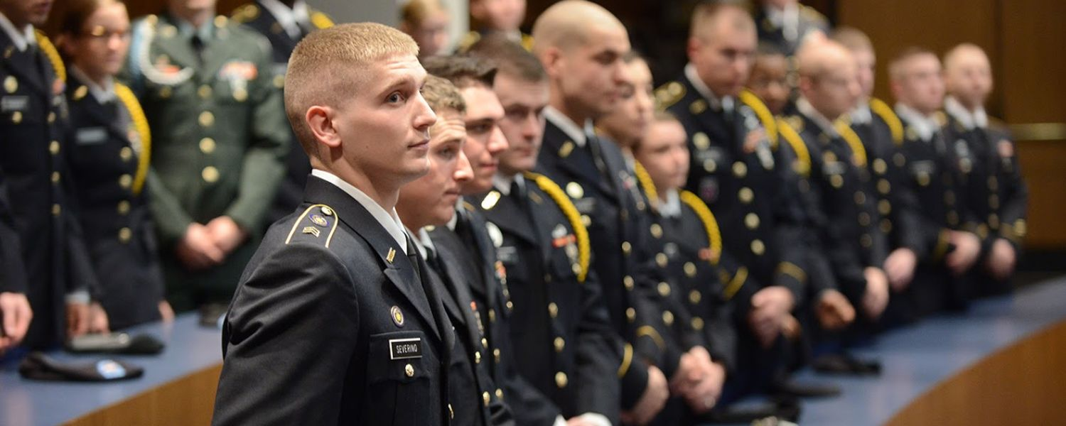 """Members of Kent State's Army ROTC program watch as two of their members are commissioned into the U.S. Army."""""""