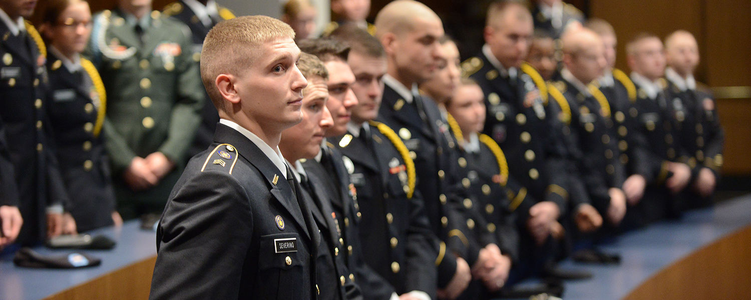 Members of Kent State's Army ROTC program watch as two of their members are commissioned into the U.S. Army.