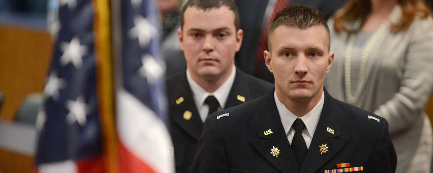 Kent State ROTC Cadets John Richards and David Herchick prepare to be commissioned as second lieutenants in the U.S. Army.