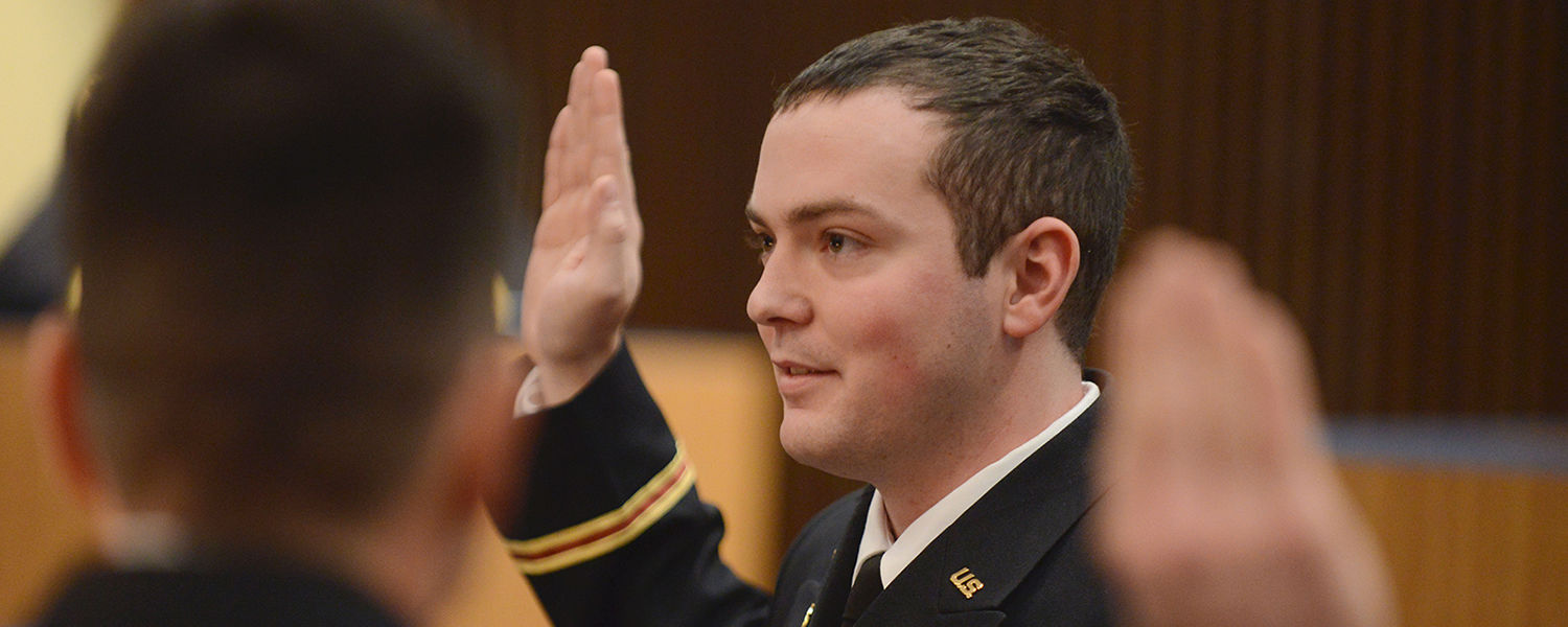 U.S. Army 2nd Lt. John Richards takes the oath of office from Lt. Col. Mark Piccone during a commissioning ceremony held in the Governance Chambers.