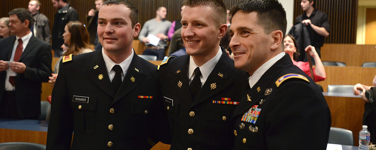 Newly commissioned U.S. Army 2nd Lts. John Richards (left) and David Herchick (center) pose with Lt. Col. Mark Piccone (right) after the commissioning ceremony.