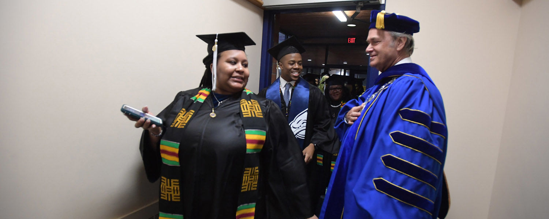 Kent State President Todd Diacon greets undergraduates