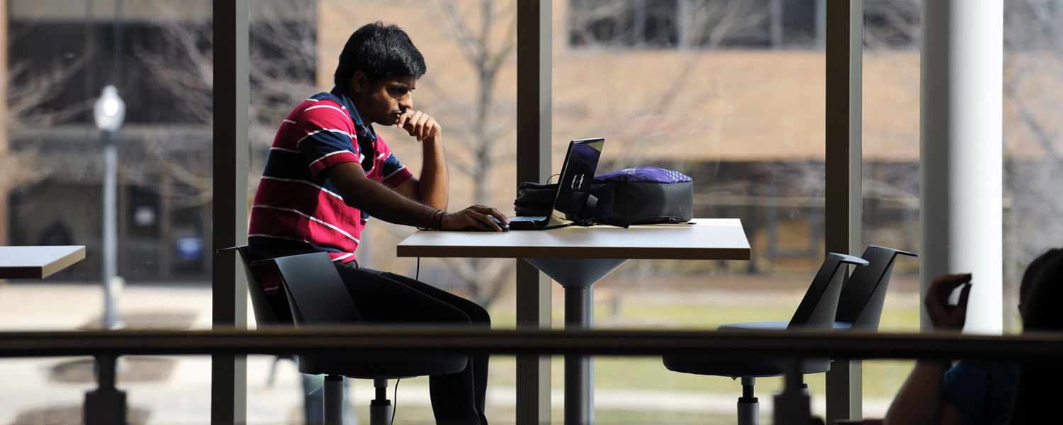 A Kent State student studies between classes on the second floor of the new Aeronautics and Technology Building.