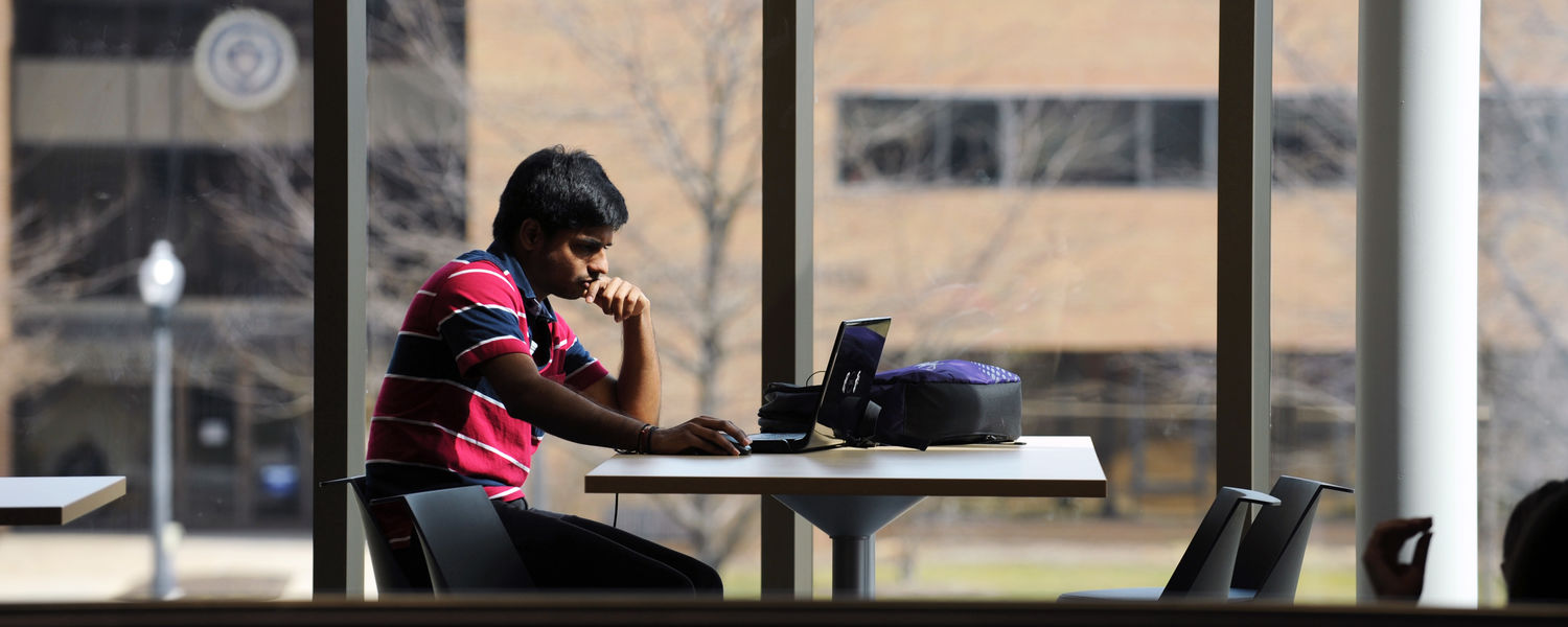 Kent State student studies between classes on the second floor of the new Aeronautics and Technology Building.