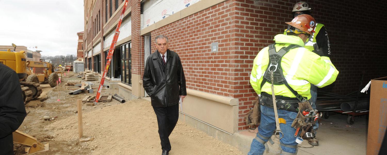 U.S. Transportation Secretary Ray LaHood walks beside the Kent Central Gateway multimodal transit center in downtown Kent.