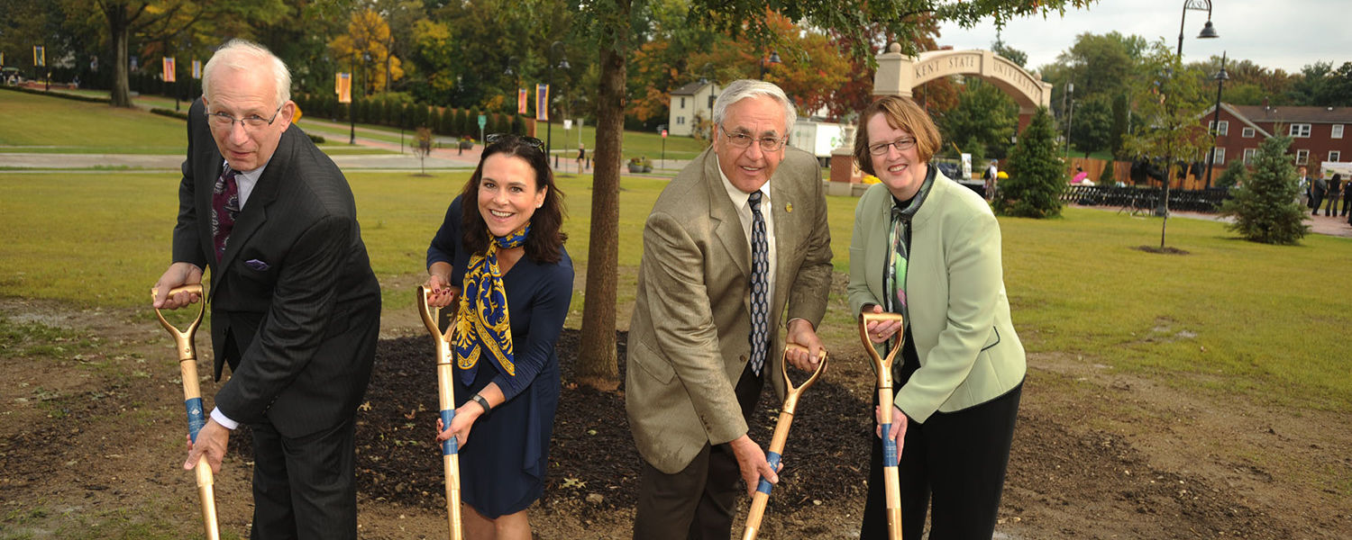 Kent State President Lester A. Lefton, Kent State Board of Trustees Chair Jane Murphy Timken, Kent Mayor Jerry Fiala and Sandra Reid from the Davey Tree Expert Company help dedicate the newly planted pin oak Partnership Tree that symbolizes the town-gown