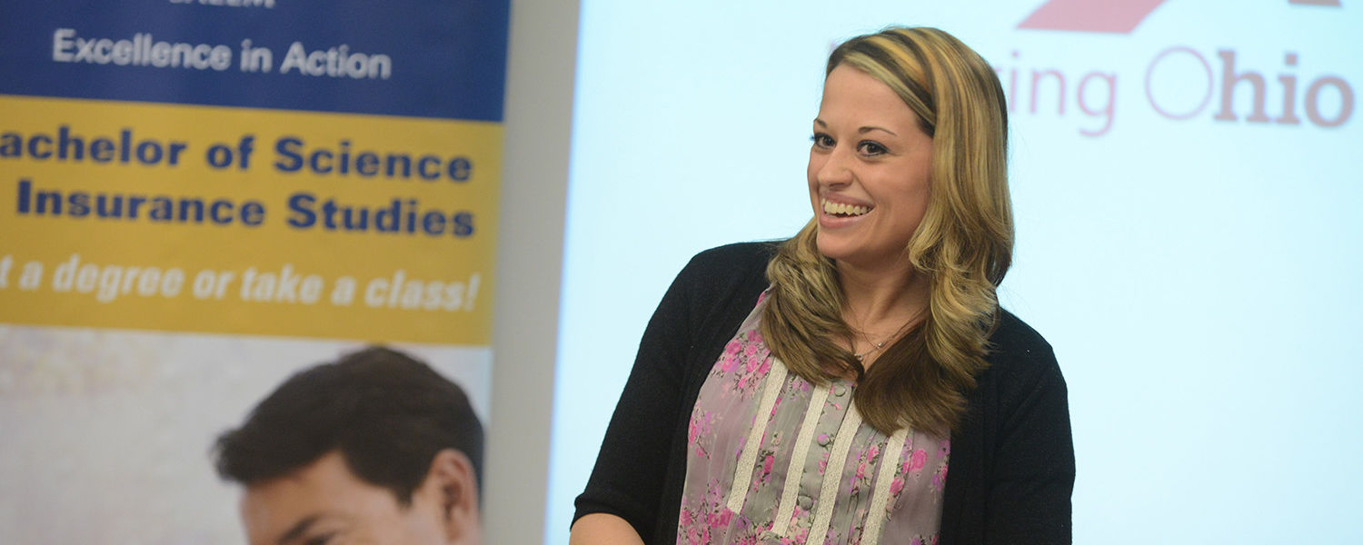 Katelyn Moore, the first Kent State student to declare the insurance studies major, speaks during a press conference about career opportunities in the insurance industry and the university's new insurance studies degree program.