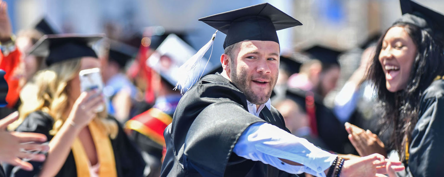 New England Patriots wide receiver Julian Edelman is congratulated by fellow Kent State graduates during the One University Commencement held at Dix Stadium.