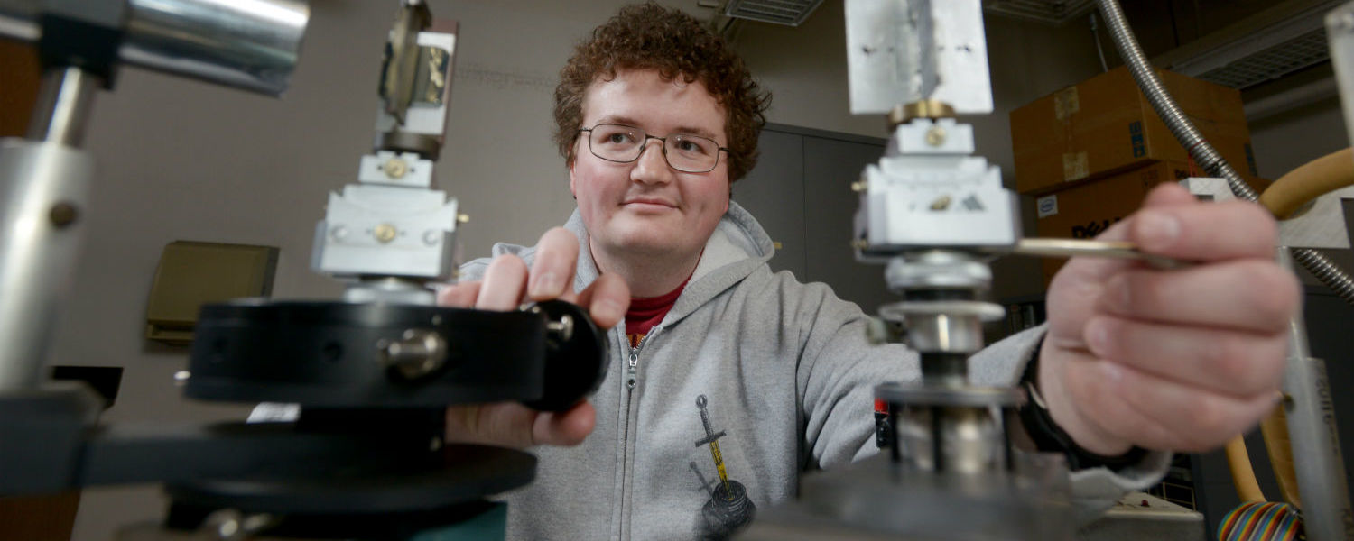 Kent State student Lewis Sharpnack studies the structure of smectic liquid crystal phases in Physics Professor Satyendra Kumar's laboratory in the Science Research Building.
