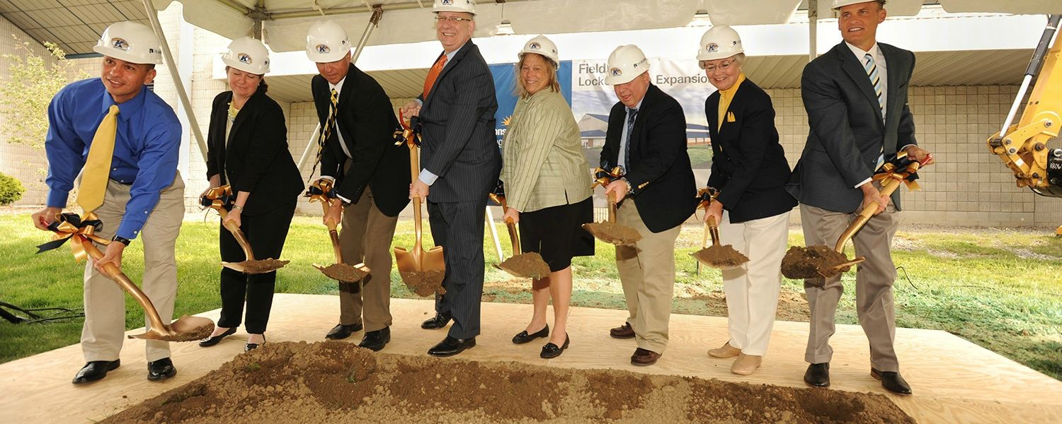 The first shovels of dirt are turned over during the groundbreaking for Kent State's Field House Locker Room project