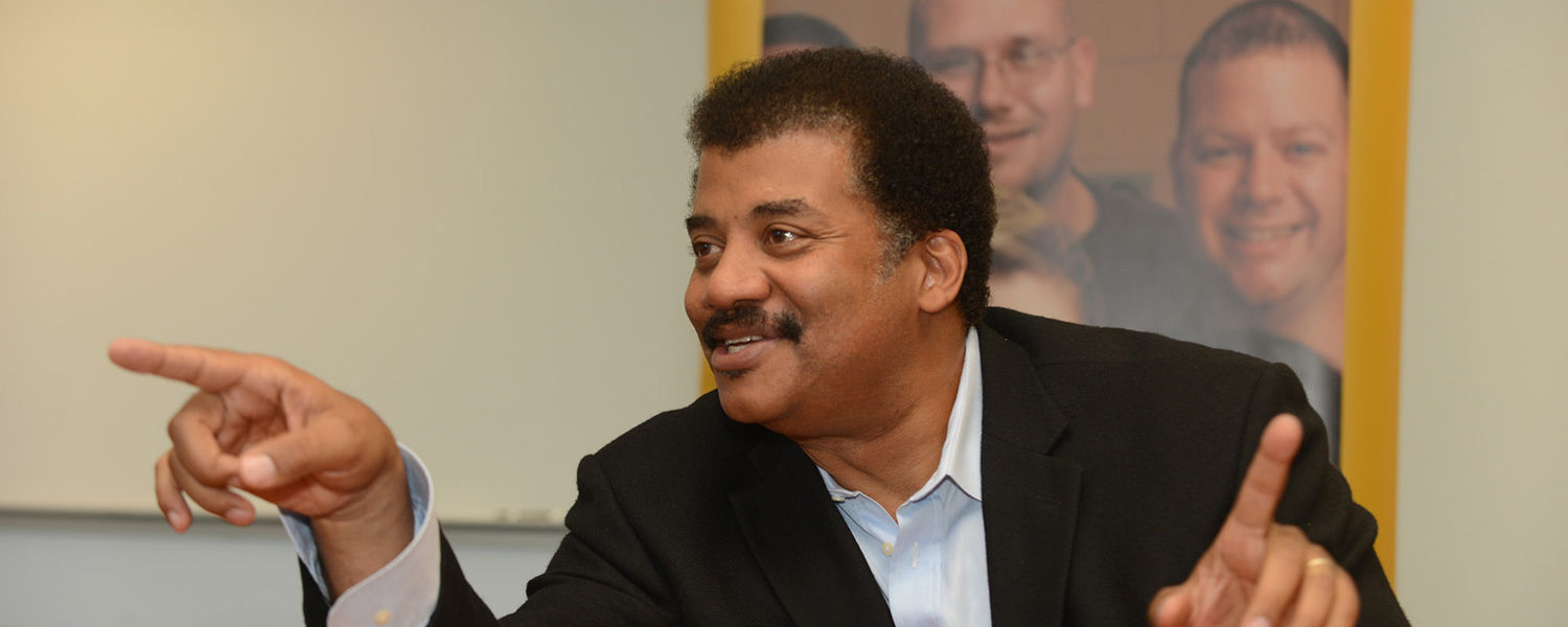 Astrophysicist Neil deGrasse Tyson speaks to members of the local media during a  press conference on Sept. 25. Tyson came to the university to speak at the third Kent   State University Presidential Speaker Series.