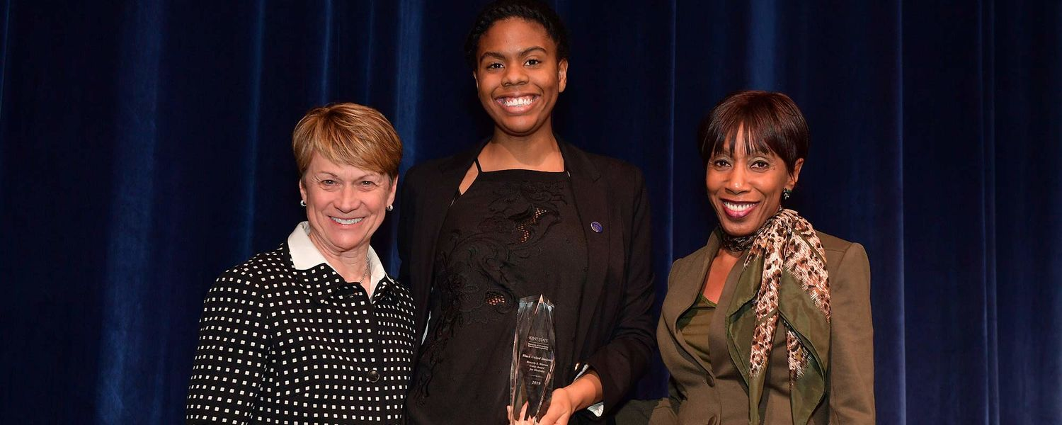 Kent State President Beverly J. Warren and Vice President for Diversity, Equity and Inclusion Alfreda Brown give the Beverly J. Warren Unity Award for Diversity to Black United Students, accepted by its president, Dartalia Alati.